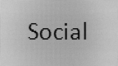Typing Social and Media words on BW PC screen Stock Video Footage