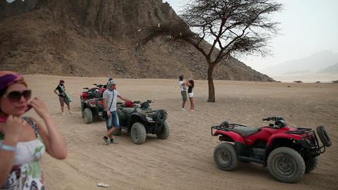 Pan shot of number of buggies for safari ride Live Action