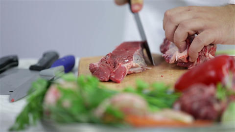 Butcher cutting red meat in to beef steak Footage