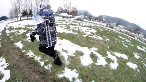 Boy runs fast past the camera Footage