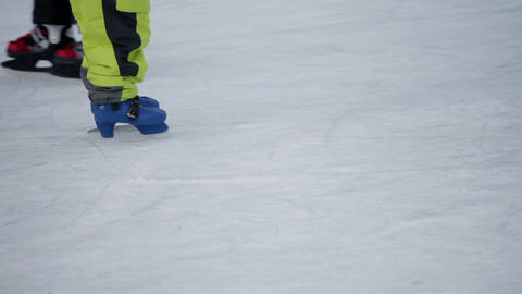 Legs Of Mother Skating Around It's Child On Skate  stock footage