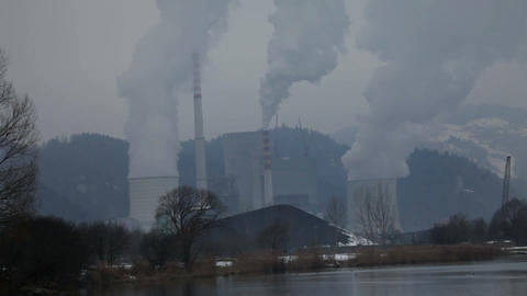 Four chimneys polluting the air with smog Footage