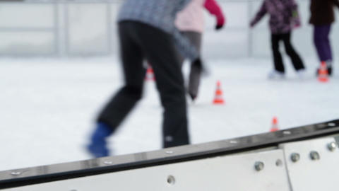 Kids skating on ice past the obstacles on ice rink Footage