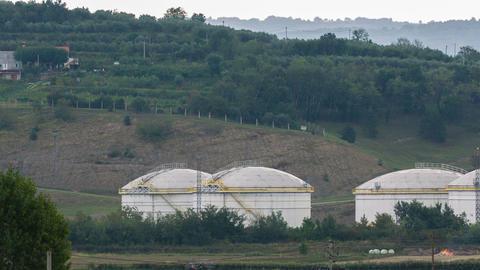 Pan shot of large number of silos various sizes Footage