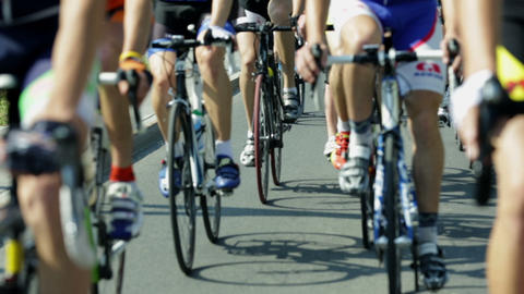Shallow focus shot of cyclists lower bodies while  Footage