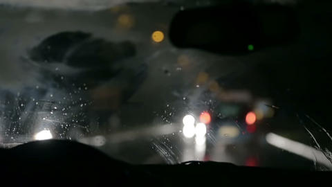 Shot of wipers removing rain from windscreen at ni Live Action