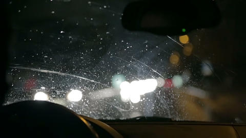 Car windscreen wipers actively remove gathered rai Live Action