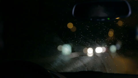 Nightdrive through the city on a rainy day Footage