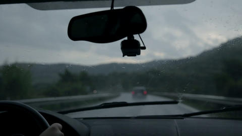 Shot through windscreen while driving on motorway  Footage