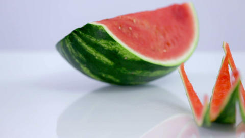 Watermelon with couple of thin eaten slices Footage