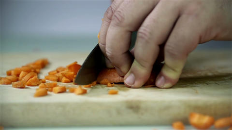 Cutting carrots on wooden desk Footage