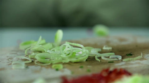 Sliced leek falling on wooden desk for slicing foo Footage