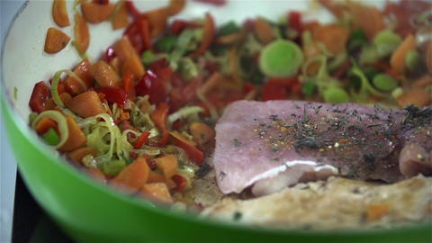 Adding Steak In Dish Full Of Vegetables stock footage