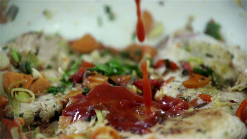 Tomato Sauce Is Slowly Dripping Onto Meat And Vege stock footage
