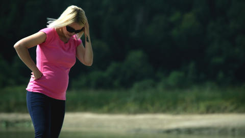 Pregnant woman looking into the floor and pressing Footage