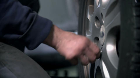 Loosening the screw on a tire Footage