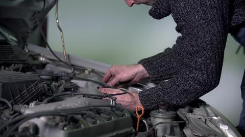 Auto mechanic sticks a sticker to the engine Footage