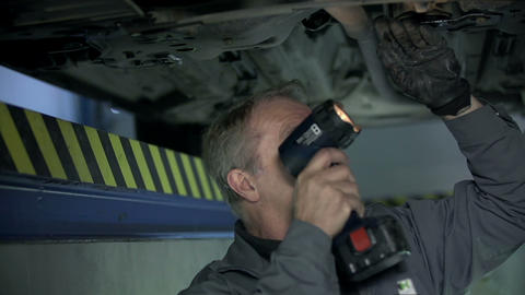 Mechanic checks the bottom of the car Footage