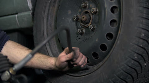 Inflating car's tire Footage