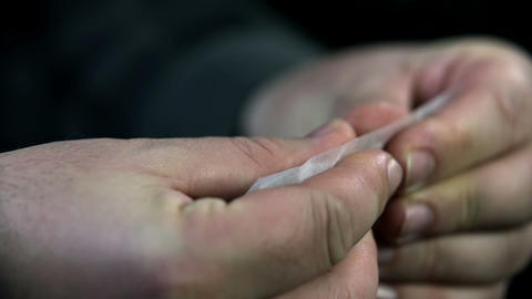 Detail of rolling a joint with both hands Footage