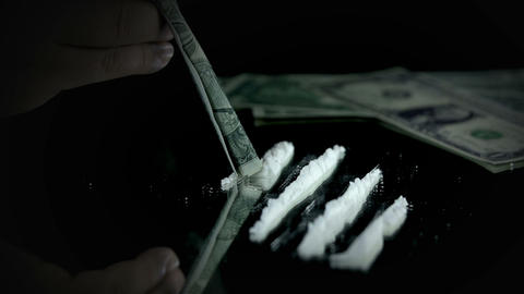 Sniffing cocaine with a dollar bill Footage