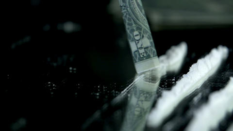 Sniffing the cocaine lines with a dollar bill in s Footage