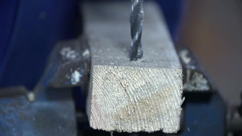 Drill bit spinning in slow motion through wood Footage