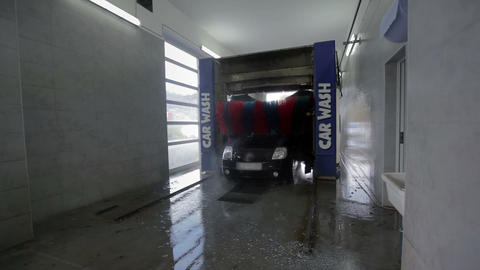 Carwash modules washing a car from all sides Footage