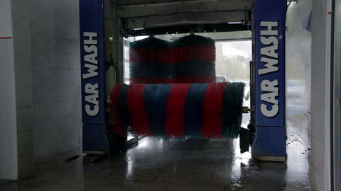 Carwash brushes in the process of washing a car Footage
