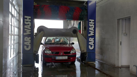 Carwash Module Raises Above The Car stock footage