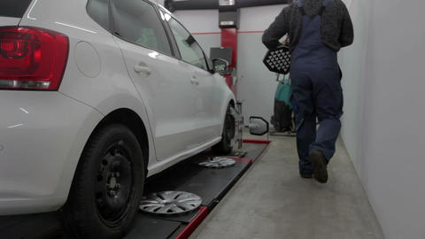 Mechanic removes metal part fastened to a tire Footage