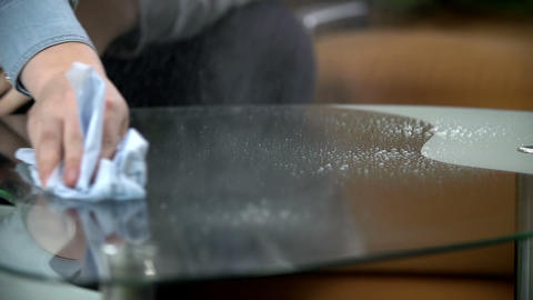 Cleaning the glass table with cloth and cleaning s Stock Video Footage