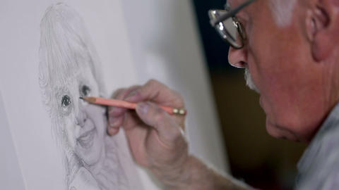 Old man shows great talent when he draws a girl wi Footage