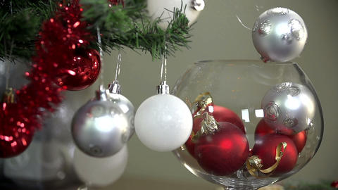 Christmas Tree Ornaments Falling In To Glass Close stock footage