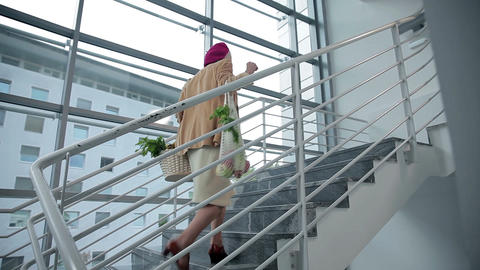 Old lady walks up the stairs Footage