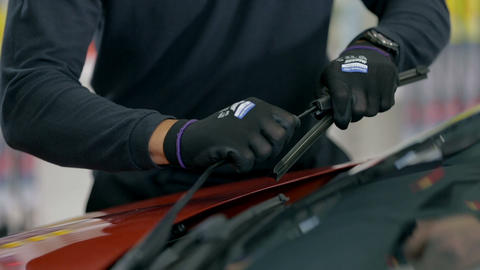 Taking the rubber off the wipers from up close Footage