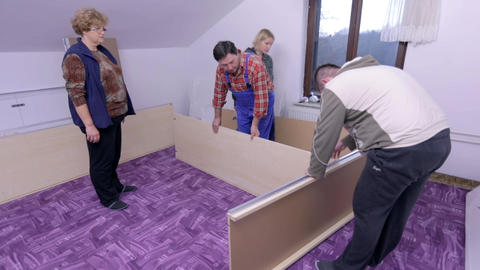 Total shot of assembling the closet with some spec Footage