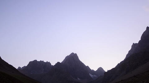 Moonlit night in the mountains. Time Lapse. Pamir Footage
