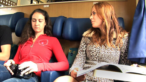 Girls talk in a passenger cabin on a moving train Live Action