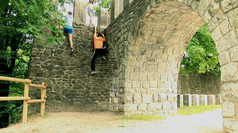 One boy climbs the wall but the other one fails to Footage