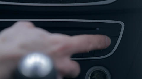 Finding the right radio channel on a car radio Footage