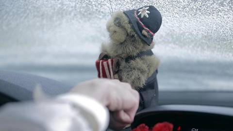 Turning on the monkey puppet held on dashboard Live Action