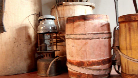 Three wooden barrels and an old lamp Footage
