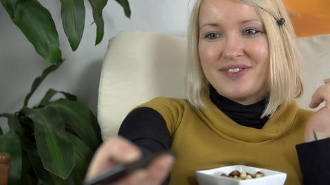 Mother to be eats snack and laughs out loud while  Footage