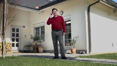 Father tries to make a telephone call in his yard Footage