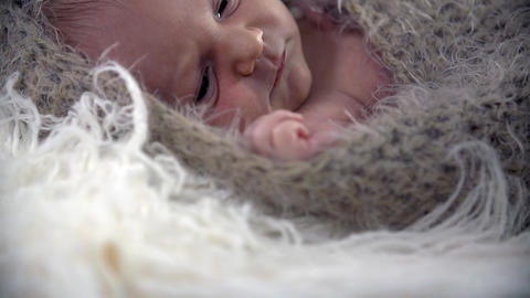 Tilt shot of baby in woollen cover Footage