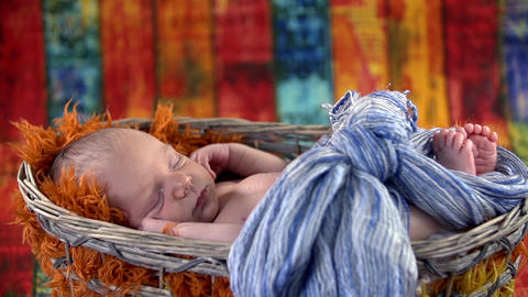 Baby laying in the basket Footage