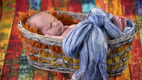 Basket with ble bow and baby inside Footage