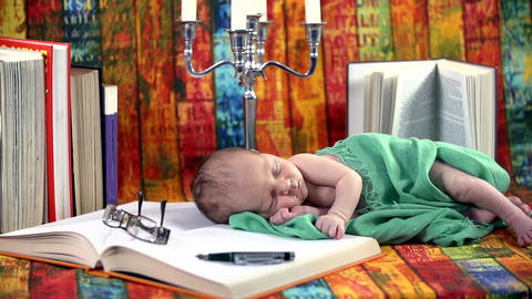 Baby sleeps on a book Footage