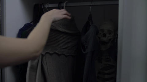 Woman can't decide what clothes to wear Footage